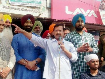 Delhi Chief Minister Arvind Kejriwal addresses the people at Dhilwan in Punjab on Sunday.