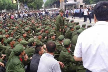 PLA veterans stage a sit-down protest outside government offices in Hubei province on May 4, 2015.