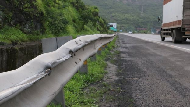 Battered motorway barrier on the Pune-Mumbai expressway