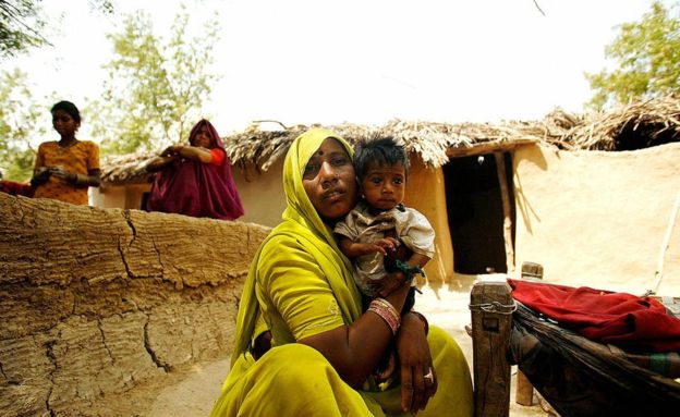 n this picture taken, 04 May 2007, Indian malnourished child, Viru (R) is comforted by his mother outside their hut at a village in Shivpuri district some 113 kms from Gwalior.